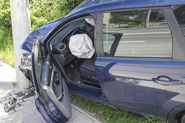 29956363 - wrecked car with opened airbags after accident